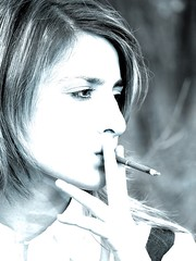 smoking girl (getmilitaryphotos) Tags: portrait woman brown girl beautiful face female hair person one holding women hand adult head cigarette smoke young smoking blond addiction tobacco