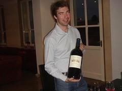 Ronan Laborde opens a small bottle of Clinet