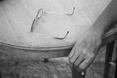 (Maieutica) Tags: wood bw woman table glasses donna hand cigarette bn smoking mano harm tavolo legno braccio occhiali fumare sigaretta mozzicone