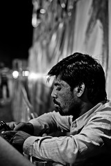 326/365. Stranger. (Anant N S (www.thelensor.tumblr.com)) Tags: portrait blackandwhite bw india monochrome photography 50mm blackwhite nikon bokeh indian fair stranger portraiture nikkor pune project365 portraitofastranger nikond3000 indianfair lensor anantns thelensor anantnathsharma