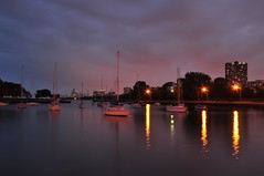 Montrose Harbor, Chicago (Seth Oliver Photographic Art) Tags: nightphotography chicago clouds reflections boats landscapes illinois nikon midwest nightlights lakes cities cityscapes lakemichigan nightshots trumptower harbors montroseharbor chicagoatnight pinoy johnhancockbuilding nightscapes chicagoskyline urbanscapes marinas secondcity citiesatnight windycity longexposures chicagoist pinegrove d90 nightexposures wetreflections 20secondexposure vroff cityofbigshoulders nd110filter iso159 manualmodeexposure willistower bigstopper setholiver1 18105mmnikkorlens tripodmountedshot remotetriggeredshot aperturef200 wbsettocloudy noppexceptforstraighteningandremovalofdustspots lightpollutioneffect