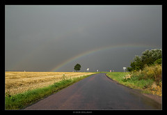 Illuminated Rain (Igor HOLLMAN) Tags: road trees sky france clouds canon landscape rainbow wheat country champs route ciel arbres fields thunderstorm nuages paysage campagne 1022mm calvados orage meteorology arcenciel darksky stormchasing bl mtorologie bassenormandie sunnyspell claicie