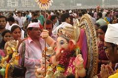 Ganpati flanked by devotees, Mumbai, India (santosh_sinha) Tags: india festival canon ganesha ganesh mumbai visarjan 2012 ganpati g12