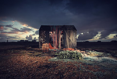 Disussed fisherman's net shed - Dungeness - Kent (Nick Caro - Photography) Tags: lighting lighthouse storm net beach nature clouds landscape boats coast kent fishing fisherman stones barrel shed shingle dungeness ropes nets barren strobe scattered romneymarsh natu offcameraflash strobist nickcaro wwwnickcarophotographycouk