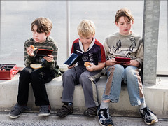 Gameboys and buns (matthijs rouw) Tags: boys sitting eating row buns gameboy