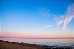 Cooden Beach (craig_prentis) Tags: pink sunset sea sky seascape beach clouds still glow colours horizon dramatic millpond groins esussex cooden craigprentis craigprentisphotography