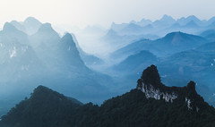 Endless Lands (One_Penny) Tags: asia china guangxi photography travel xingping canon canon6d morning sunrise mist fog foggy mountains scenery damianhill blue light hills land nature karst view rural
