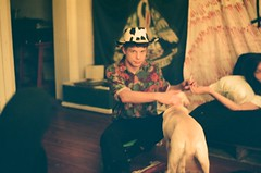 Mac and pup, at Heaven's Gate (emily_quirk) Tags: film emilyquirk 35mm nikon olympus nashville neworleans staypoorshootfilm filmsnotdead heavensgate showspace showhouse diy noladiy macfolger puppy pup shredtilyouredead banner futon partydog louisiana cowboy cowboyhat