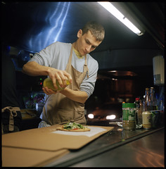 Luciano (David Stumpp |[o]| Photography) Tags: lighting wood uk blue light england food reflection green 120 film night rolleiflex photoshop evening three lab conversion bottles kodak scanner united citroen creative kingdom artificial can headlights apron pizza burning cardboard stove nightime oxford 400 epson converted vendor pelicula boxes soda van suite pizzeria portra developed oils artisan hy luciano headlamps planar cs3 pellicola 35f v500