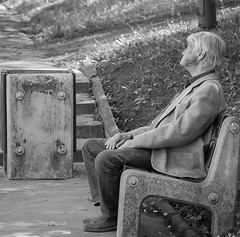 - (Szeregowy) Tags: park people blackandwhite man bench nikon poland planty bialystok transcendentalcommunication