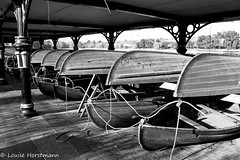 Boats (Lou H.) Tags: park blackandwhite canon boats cardiff canoe rowing ropes roathpark