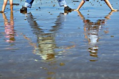 on the beach... (ggcphoto) Tags: pink blue ireland sea feet beach water reflections 50mm legs sandals waterford bearfeet sonyalpha cloneastrand gettyimagesirelandq12012 yahoo:yourpictures=reflectionsv2