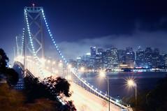 bay bridge at night (andrew c mace) Tags: sanfrancisco longexposure skyline night downtown cityscape treasureisland financialdistrict baybridge yerbabuenaisland nikkor50mm colorefex nikoncapturenx nikond90