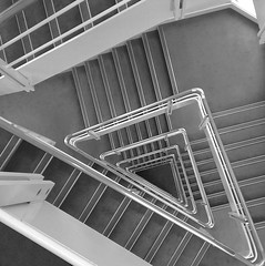 Stairs and angles (blacksplat) Tags: cameraphone white abstract black lines architecture stairs square triangle steps perspective angles stairway staircase squareformat repeat triangular escaliers htc repetitive