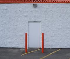 Orange (Grandpaparazzi) Tags: door roof light orange white toronto yellow wall pavement stripes posts asphalt homedepot