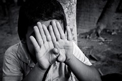 Hiding............ (~~~Saif~~~) Tags: boy portrait smile face children happy nikon mood village child shy hide 1855mm nikkor bangladesh afs chandpur concealment d5100 nikond5100