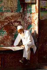 Muslim man reading a paper (BDphoto1) Tags: india man color vertical outdoors sitting indian muslim islam photograph ethnic cultural islamic