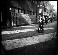 Untitled,  Clothilde BL/Lost In Transition (Lost In Transition Project) Tags: rodinal rollei rpx fuji fujipet 120 mediumformat bw blackandwhite nb noiretblanc monochrome japan japon osaka lostintransition street streetphotography shadow city urban people bike film analog argentique