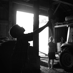 The old rope swing in the hay barn (Sean Anderson Media) Tags: barn hay hayloft ropeswing moody blackandwhite silhouette rimlight backlit dramatic curious child farm oldbarn sonya7rii nikon50mmf14 primelens lensadapter fotodiox