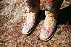 [fancy boots] (world wide flan) Tags: love film oklahoma analog cowboy peace fuji heart boots olympus om10 iso 400 tulsa cowgirl ok