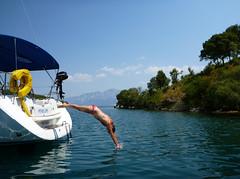 greece meganisi abilikebay sunsail ionian diving flotilla yacht bikini woman sailboat mediterranean