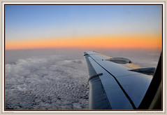Sunset Flying (Marc Geuzinge Photography) Tags: travel sunset sky orange window airplane evening flying nikon mood glow view aircraft wing klm 70 fokker d90 marcgeuzinge marcgeuzingephotography ciityhopper
