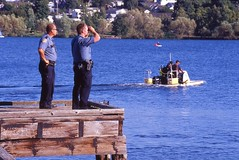 Day 248/365 - Manhunt at Bird Shit Island (Great Beyond) Tags: seattle lake color slr film water analog 35mm boats eos iso100 boat is washington dock kodak police slide ishootfilm slidefilm september greenlake 35mmfilm cop copper 365 usm eastman slides 70300mm ektachrome 3000v theman 2012 canonrebelti kodakfilm 366 eastmankodak seattlewashington kodakektachromee100vs f456 project365 ef70300mmf456isusm filmisnotdead ektachromee100vs canoneosrebelti project3651 project366 september2012 rokinon35mmf14aspherical