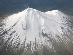 Mt Taranaki and Fanthams Peak (blue polaris) Tags: park new mountain snow ice tooth landscape island volcano shark scenery mt cone north flight peak aerial hut zealand national crater nz summit volcanic taranaki egmont syme fanthams fantham