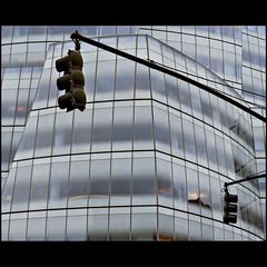 Hanging around (Maerten Prins) Tags: windows newyork reflection building glass lines modern america lights traffic unitedstates manhattan curves gehry hanging amerika frankgehry iac stoplichten