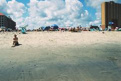 A woman stares into the water (andrewkatchen) Tags: asburypark newjersey jerseyshore beach ocean nikon film 35mm portra400 n6006