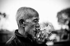 Smoking old man (snowpine) Tags: street streetphotography streetportrait people portrait candid smoking oldman china chinese bw blackandwhite blackwhite
