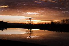 The Overshot Windmill (edwinemmerick) Tags: silhouette sunrise river lake sky cloud windmill