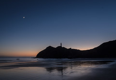 Lighthouse silhouette (dave.fergy) Tags: lighthouse beach sunrise water architecture moon reflection dawn building landscape reflect reflected reflectingreflections castlepoint wellington newzealand nz