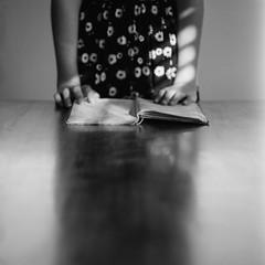 A work in progress (spannerino) Tags: canon9000f film filmlives handprocessed indoor ilfordlc29 mediumformat monochrome newzealand slr scanned vintage vintagecamera white window 120mm 120mmfilm 120mmcamera 120mmvintage bronica bronicasqa 150mm kodak400tx zenzanon blackandwhite depth field table book girl zenzabronicasqa