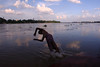 Leap frog (Rajib Singha) Tags: travel river outdoor swim jump clouds interestingness flickriver canoneos400d sheoraphuli hooghly westbengal india