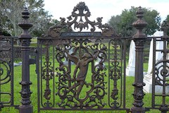 L.H. Thistle (pburka) Tags: gate grave cemetery ironwork iron metal metalwork figure ornate natchez mississippi ms angel crying
