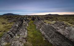 Crack in the ground (Arnar Bergur) Tags: mountain nature grass stone clouds landscape outside lava iceland moss crack lavafield greenmoss landslag sland arnarbergur