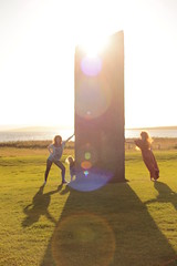 "day 174 - Three sisters, a stone and a sunset (lions + tigers + bears oh my) Tags: lighting old uk light sunset shadow summer portrait woman sun selfportrait art english history me archaeology girl silhouette rock sisters standing self dark myself circle happy photography orkney standingstones stones year young story teen together photograph teenager 365 concept conceptual teenage stoneage stonecircle sunflare sunglare art"" 365days orkadian ""fine"