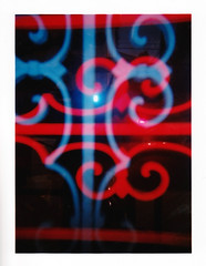 Ghost in the Gate (Dead  Air) Tags: abstract reflection window portland holga gate pattern darkness flash stjohns glowing ironwork ghostly telephonewires lombardstreet exposures coloredflash