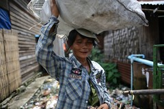 In the slums of Yangon, Myanmar (Michal Przedlacki) Tags: poverty tattoo neglect children hope garbage yangon burma dump myanmar burmese birma slums rangoon dwellers yangonmyanmar3august2012 dowbon
