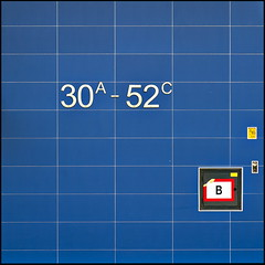 That's not where I live! (Maerten Prins) Tags: blue b urban abstract building sign yellow wall grid rotterdam flat letters numbers tiles font 30a strak 52c
