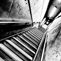 Uninviting [EXPLORED] (Aaron Yeoman) Tags: city uk greatbritain travel light shadow england urban blackandwhite bw london lines station architecture modern stairs dark underground subway blackwhite europe shadows metro unitedkingdom metallic empty sony tube perspective railway gritty eerie line staircase gb tubestation haunting londonunderground subwaystation alpha futuristic thetube metrostation tfl lul theunderground westminsterstation undergroundstation rapidtransit westminstertubestation westminsterundergroundstation a700 metropolitanrailway sonyalpha700 dslra700 sigma1020mm1456exdchsm silverefexpro2