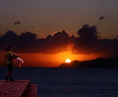 L'alba della vita (meghimeg) Tags: sea sun girl clouds sunrise doll nuvole mare alba sole bambola bambina 2011 flickerland
