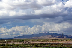 View from Comfort Inn & Suites (ScribeGirl) Tags: railroad sky cloud mountain newmexico southwest landscape desert traintracks pole deming