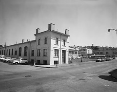 Outdoor Shot of Facade of 24th and Utah Garage | May 2, 1969 | M0602_2 (SFMTA Photo Archive) Tags: sanfrancisco california ca 1969 shop exterior publictransportation outdoor garage parking streetscene muni transportation intersection missiondistrict streetview potrerohill 24thstreet motorcoach snodgrass may2 sfpuc utahstreet sanfranciscomunicipalrailway sfmta sanfranciscomunicipaltransportationagency sanfranciscopublicutilitiescommission acetatenegative kensnodgrass m0602 24thandutah