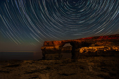 One Starry Night... (Maverick) Tags: outdoor night serene landscape me stars startrail trails trail polaris earth constellation water beach gozo window azure azurewindow malta island new experiment wellies ocean sea seaside shore dusk d800 nikon summer nature art light sky blue mediterranean mediterraneansea intervalometer starstax moon moonlight