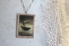 Paper Boat Collodion (angiebrockey) Tags: paperboat boat sea ocean nature water sepia bw tintype wet plate collodion blackandwhite black white angiepemberbrockey angie pember brockey silverandglass silver glass floating dreamy dream ethereal lfcamera lf camera large format tintypejewelry jewelry photo pendant necklace