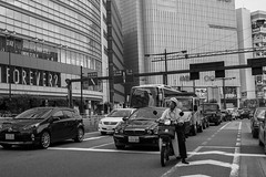 head start (edwardpalmquist) Tags: tokyo japan travel city street blackandwhite monochrome outdoors architecture building car road scooter people man