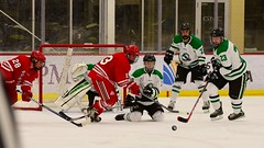 Scramble in front! (R.A. Killmer) Tags: ice hockey skate skill stick puck sru slippery rock green white hit check fast