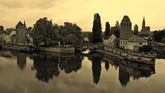 La Petite France (lunaryuna) Tags: france lalsace strasbourg unesco site water riverill covertbridges lespontscouverts urbanlandscape landmark architecture medievalarchitecture reflections seeingdouble urbanmirrorworlds sepia monochrome trees urbanconstructs lunaryuna